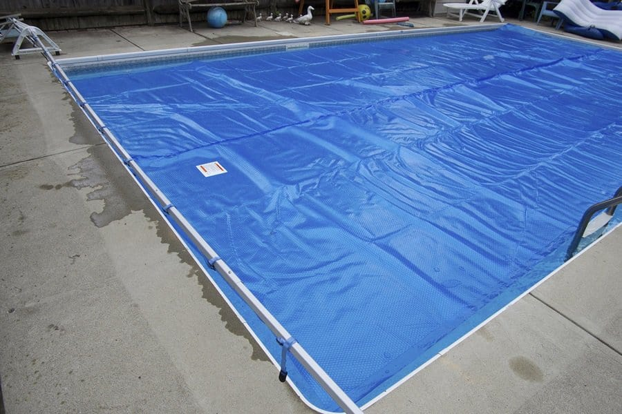How to Make a Pool Cover from a Tarp